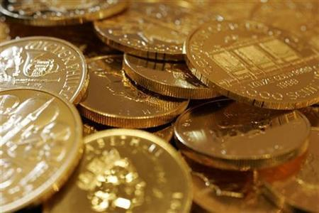 Gold coins are displayed at the Ginza Tanaka store in Tokyo September 18, 2008. REUTERS/Yuriko Nakao